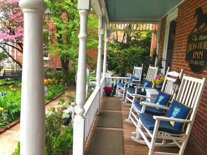 OUR FRONT VERANDA WITH WHITE ROCKING CHAIRS